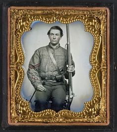 William Jenkins, North Carolina soldier, in artillery uniform, with percussion rifle converted from flintlock - in case