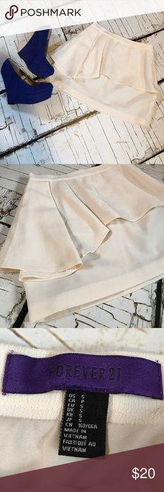 Forever 21 Adorable skirt. Cream colored. Love the extra fabric they added to the side! 😍 good used condition. Lots of life left! Pair with heels,boots or flats! Forever 21 Skirts Mini