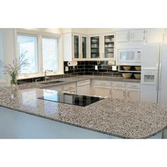 White Kitchen Cabinets With Granite Countertops white kitchen cabinets new caledonia granite countertop subway