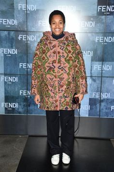 Tamu Mcpherson style includes lots of bold statement coats - come see her 30 best outfits.