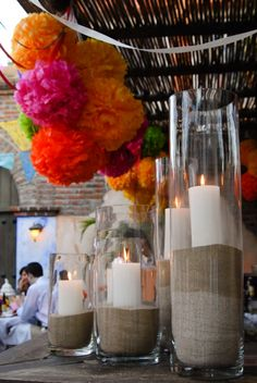 Tall vases with sand and candles.