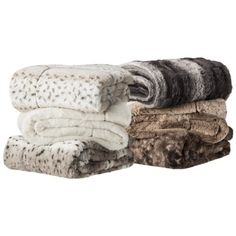Faux fur throws! On sale for only 19.99 each. i bought the cream and tan ombre; LOVE