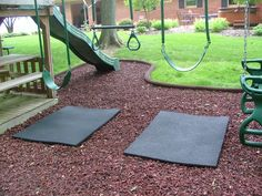 rubber mat under swings so you don't wear that mulched area down.  also like the shape of the mulch area coming out around slide.