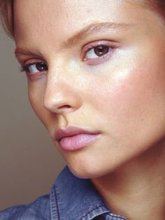 soft, angled eyebrows with loads of highlighter and light pink or lilac stain on eyes, lips and cheekbones