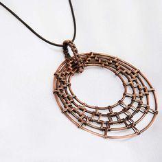 woven circles copper pendant.