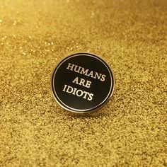 "Misanthropy at it's best. Our first ever release and a best seller ever since. 20mm (0.8"") gold and black hard enamel pin with a secure..."