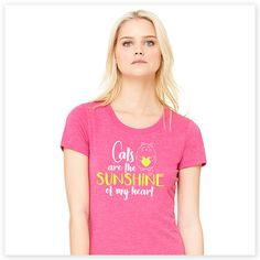 """When you're a cat lover, everything about them makes you happy. This adorable """"Cats are the Sunshine of My Heart"""" tee sums that sentiment up purr-fectly. Super-soft, ultra-comfortable shirt in a pretty pink color is made of 50% poly, 25% combed and ring-spun cotton and 25% rayon. Design exclusive to Zee & Zoey's Cat Creations!"""