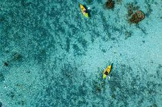 Paddling in Polynesia - Canoe and kayaks in Polynesia Cook Islands tropical paradise Aitutaki aerial panorama landscape