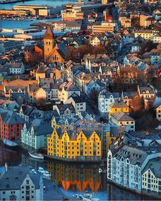 Top travel photos from around the world. Make your own memories by travelling. Help improve quality of life of the country you visit. Top travel booking sites recommended by experts Alesund, Earth City, Travel Booking Sites, Travel Abroad, Travel Europe, Europe Europe, Adventure Is Out There, Best Cities, Greece Travel