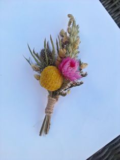 Dried Flower Buttonhole - Country Chic  A pretty rustic buttonhole with all natural dried flowers including; pink Acroclinium, Craspedia, Quaking Grass, Statice, Wheat and Eryngium with a hessian string. Perfect for any rustic or country style wedding. A great wedding keepsake. Alternatively they make great wedding favours or place setting. The buttonhole measures approximately 14cm in length and 8cm at its widest. Dried flower material is delicate in its nature and can the occasional petal…