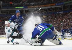 San Jose Sharks forward Tommy Wingels kicks up a snow shower after making a strong move to the net (March 3, 2015).