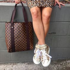 Street Style! Louis Vuitton Ebene Damier Canvas Beaubourg Tote Bag paired with Pierre Hardy Gold Metallic Leather Disco High Top Sneakers now available to purchase on www.mymoshposh.com! #streetstyle #fashion #trendy #louisvuitton #lv #lvdamierebene #pierrehardy #socute #love #inlove #luxury #lvtote #moshposhfinds #mymoshposh #shoelover #talkshoes #purselover #purseblog #designerhandbags #designershoes #designerconsignment