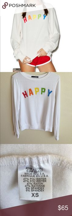 "NWOT Wildfox Couture ""Happy Girl"" Size XS Constructed from a super soft perfectly distressed fleece material with an effortless oversize fit that's beyond comfy. Featurin' ""HAPPY"" in cheerful rainbow colors printed across the front, long sleeves and banded trim, this classic sweatshirt will give ya countless reasons to be happy.  Flat lay measurements may be off depending on stretch of the material  Arm pit to arm pit 18"" Length 22.5"" Sleeve 25""  Orders ship out same or next day! Wildfox…"