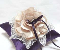 Wedding ring pillow champagne bloom with silver lace on purple ring pillow. $40.00, via Etsy.