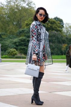 A street style star in a PVC coat at London Fashion Week 2015. (Photo: Getty Images)