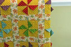 Polka-dot pinwheels with prairie points: good baby quilt idea