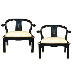 Pair of Hollywood Regency Armchairs in the Style of James Mont  USA  Circa 1960  A pair of high gloss black lacquered armchairs in the manner of James Mont. They have traditional Asian elements with brass accents. Seats are upholstered in faux crocodile leather. Seat height is 17 inches.