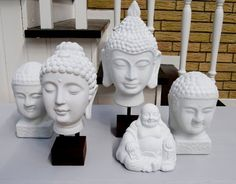 Collection of all white buddha busts.