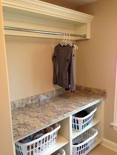 Laundry Room - I love the subtle under-cabinet hanging rods. Very ...