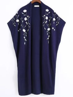 83e1e3c8e SheIn offers Navy Floral Embroidery Poncho Sweater   more to fit your  fashionable needs.