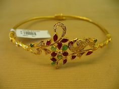 Gold and Diamond jewellery designs: bajubandh armlet ara vanki designs from devi jewellers