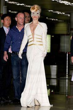 "Lady Gaga arriving in South Korea to kick off her highly-anticipated ""Born This Way Ball"" concert tour in an Atelier Versace gown."