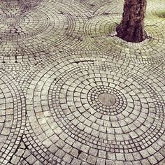 Image result for Round pebble pavers with white stones