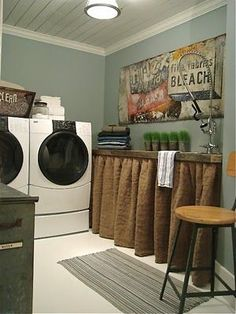 laundry room- that curtain is a neat idea to hide exposed drainage pipes & plumbing