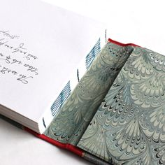 Matt's Travel Journal handmade by Ruth Bleakley with interior bouquet marbled endpages and exposed stitching