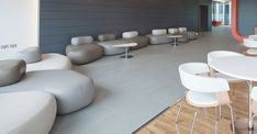Natural scattering of pebble-like seating for  creative reception and breakout  spaces.