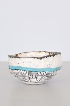 Hand-pinched bowl with blue stripe from Brooklyn artist Suzanne Sullivan. Due to their handmade nature, each bowl is different in pattern and size. Use to hold jewelry, small items or for kitchen serv