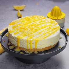 This zesty lemon cheesecake recipe has a lemon drizzle cake base, combining two of our favourite desserts
