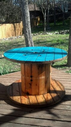 Commercial electrical spool turned into an outdoor table