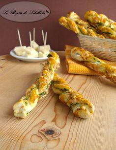 Ricetta per realizzare dei deliziosi grissini di sfoglia ripieni di formaggio e cime di rapa.