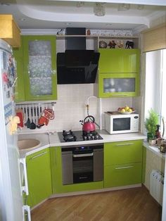 Don't feel limited by a small kitchen space. Get design inspiration from these charming small kitchen designs. Kitchen Room Design, Kitchen Sets, Home Decor Kitchen, Interior Design Kitchen, Home Kitchens, Kitchen Walls, Decorating Kitchen, Green Kitchen, Mini Kitchen