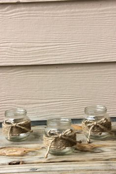 These are small jars (baby food size) wrapped by hand in hemp and topped with a bow! These are perfect for any country or rustic themed wedding. A small candle fits perfectly inside. They can be used for small decor any where for the wedding including centerpieces! After the wedding, they will ma...
