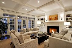 Love this room and how open it looks. with a TV above the fireplace, and the french doors on the side, beautiful!