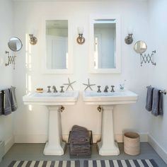 The reconfigured space now fits two pedestal sinks and mirrors that better accommodate morning routines. A large skylight floods the otherwise windowless room with sunlight.