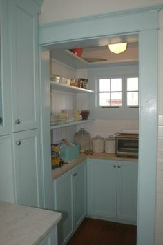 Small pantry with light blue cabinets from Gardenweb.