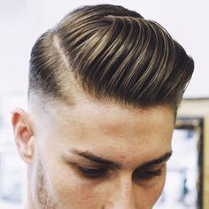 High Skin Fade with Hard Side Part and Brush Back Fringe
