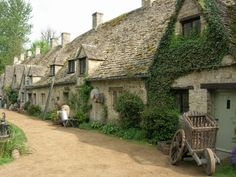 """Bibury, England Picturesque stone cottages dating back to the century form quaint honey-colored rows that earned the title """"the most beautiful village in England. The Beautiful Country, Beautiful Places, Cottages Anglais, Arlington Row, Pictures Of England, Cotswold Villages, English Village, English Cottages, Stone Cottages"""