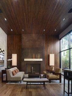 Great wood and wonderful fireplace surround of oxidized steel... William Hefner Architecture Interiors & Landscape modern living room