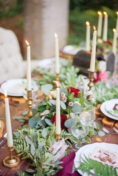 Rustic Tablescape with Foliage Runner & Candles | Photography: Delaney Dobson. Read More: http://www.insideweddings.com/weddings/alfresco-celtic-inspired-wedding-styled-shoot-with-rustic-details/858/