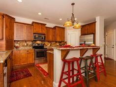 Traditional Kitchen with Breakfast bar, Slate Tile, Undermount Sink, Kitchen island, Hardwood floors, Complex Granite, Flush