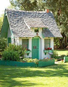 Love this one, shed turned into a whimsical playhouse. Love the roof style and decorative accents. I would live in this shed/playhouse.