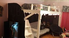 Homemade Loft.  Top has built-in night stand and room to walk on the side of the bed.  The bottom is large enough for a futon and side table.  Under the stairs is a small closet with a light, painted in chalkboard paint.