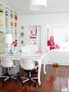Dining table used as desk and floor to ceiling shelving for awesome office storage