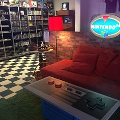 Gaming Seating Area at Café på Bit - Video Game Store and Cafe in Sweden… Battlefield 1 Xbox One, Retro Game Store, Game Cafe, Video Game Rooms, Gamer Room, Retro Video Games, Entertainment Room, Room Themes, Nintendo