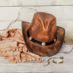 Ladies, take them by storm in this hat! Bringing a handcrafted pinch on the crown that gives you that carefree Double G Western appeal, the Women's Cyclone leather cowboy hat is available in a large variety of distinctive colors that will please any personality and match your mood no matter which way the wind blows. #hats #cowboyhats #cowgirlhats #ahm #americanhatmakers Leather Cowboy Hats, Cowgirl Hats, The Crown, Personality, Mood, Lady, Colors, Fashion, Moda