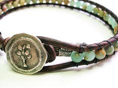 Gemstone leather wrap bracelet, Boho chic jewelry, stackable bracelet, aqua terra jasper, Hill Tribe silver, sky blue, terra cotta. $35.00, via Etsy.